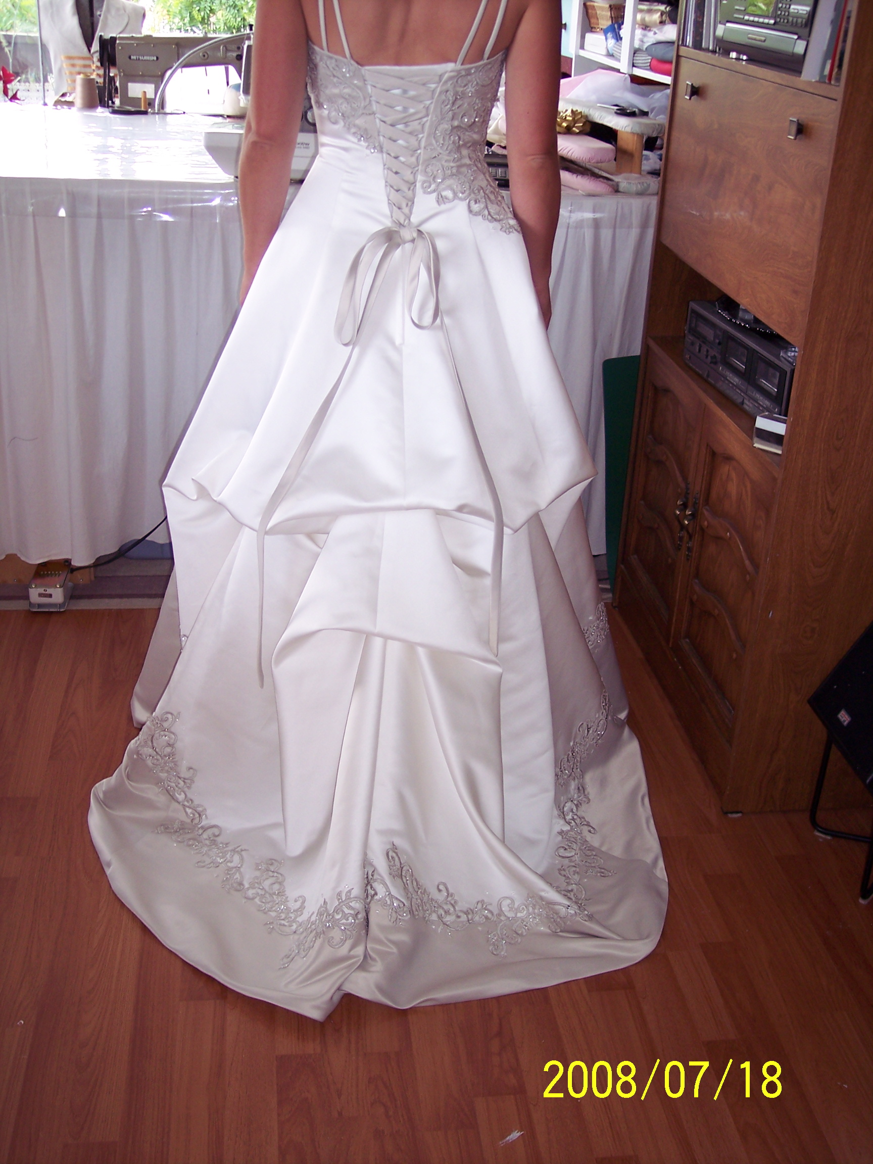 Wedding dress alterations sew it all for Wedding dress train bustle
